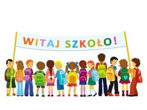 """Dzieci oraz banner """"Witaj szkoło!"""""""